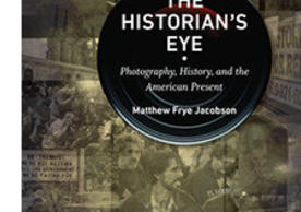 Book cover, showing a camera lense superimposed to old photographs in sepia.