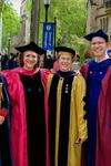 Four Yale administrators standing side by side in academic robes.