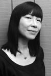 Black and white portrait of Pamela Lee.