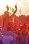People enjoying an outdoor concert
