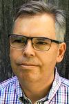 Portrait of Mark Peterson, smiling.