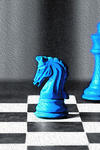Illustration of chess board with pieces in blue and red