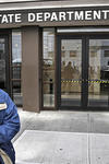Visitors to the Department of Labor are turned away at the door by personnel due to closures over coronavirus concerns, Wednesday, March 18, 2020, in New York. (AP Photo/John Minchillo)