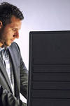 Stock image depicting a man voting